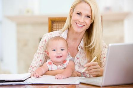 Mom At Laptop With Baby