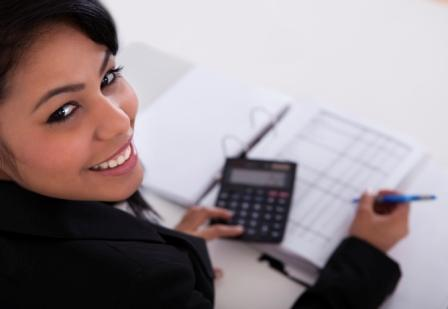 Businesswoman Doing Calculations