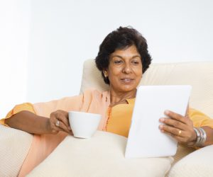 Mature Woman With Coffee and Tablet